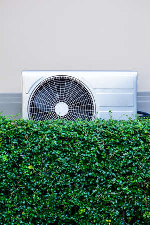 compressor: air compressor on wall with green tree