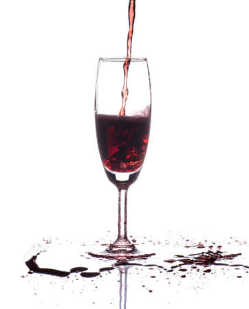 red wine pouring: red wine pouring into wine glass isolated on white Stock Photo