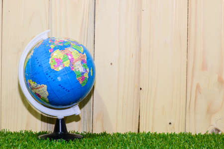 glass globe: Environment concept, glass globe and wood background Stock Photo