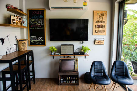 coffeeshop: AYUTTHAYA, THAILAND - 20 DECEMBER 2015- Editorial: Fantastic coffeeshop interior with  chair at Morning Coffee Shop Editorial