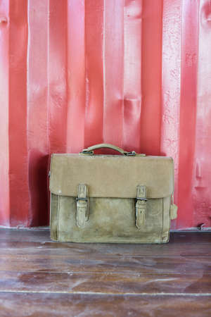 duffel: Brown Leather laptop bag corporate on old wooden floor.