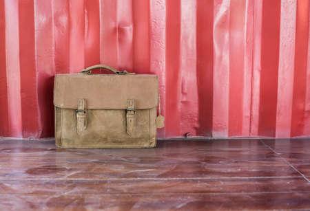 saddlebag: Brown Leather laptop bag corporate on old wooden floor.