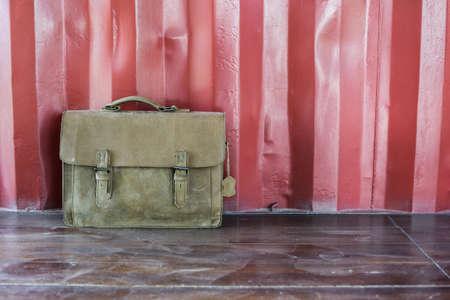 haversack: Brown Leather laptop bag corporate on old wooden floor.