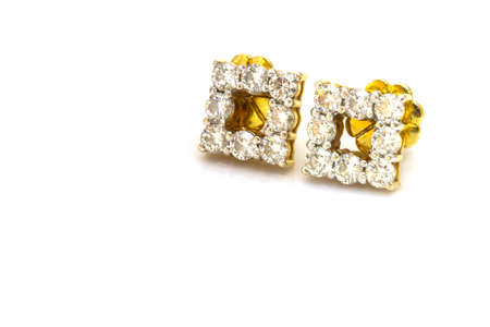 diamond earrings: A couple of diamond earrings on white