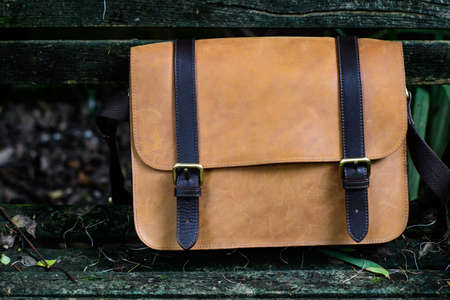 saddlebag: Brown Leather laptop bag corporate on old woden chair