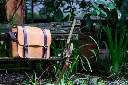 Brown Leather laptop bag corporate on old woden chair