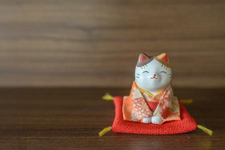 Maneki Neko cat Common Japanese sculpture bring good luck  photo
