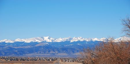 The Rocky Mountains in Colorado rise above the eastern prairie. Stock Photo