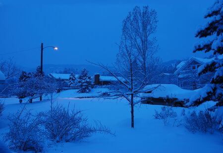 blanketed: Haunting Urban Scene Blanketed in Fresh Snow in Early Dawn Stock Photo