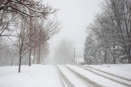 An urban street during a heavy snowstorm Banco de Imagens - 4625984