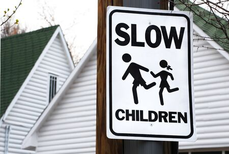 Neighborhood sign asks drivers to slow down for children