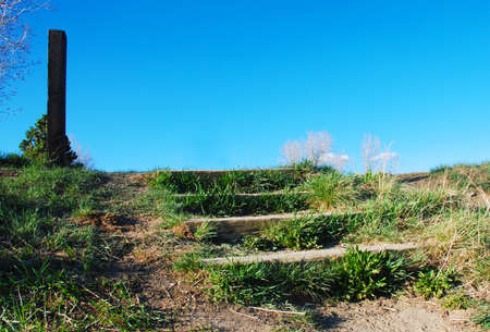 Rustic grassy steps lead up to the horizon