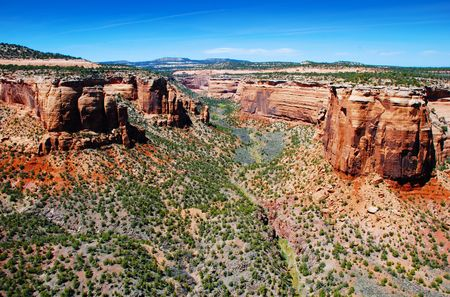 mesas: Gentle canyon between towering red mesas in the colorful Colorado Southwest