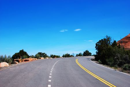 Open road leads through the Colorado National Monument in the US Southwest