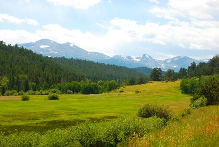 mountaintops: Scenic view of a lush valley and the Continental Divide in the Colorado Rocky Mountains