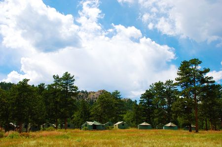 roughing: Small group of tents in a natural setting Stock Photo