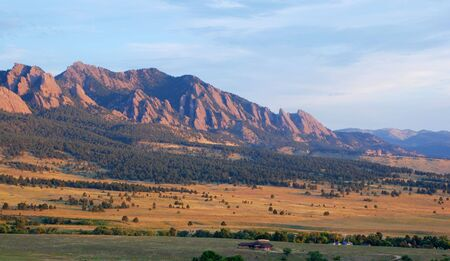 Sunrise hits the Flatirons and Bear Mountain next to Boulder, Colorado