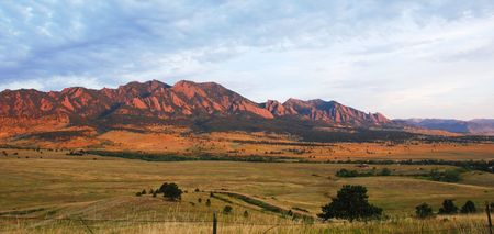 openspace: The mountains above Boulder, Colorado are bathed in orange light at sunrise