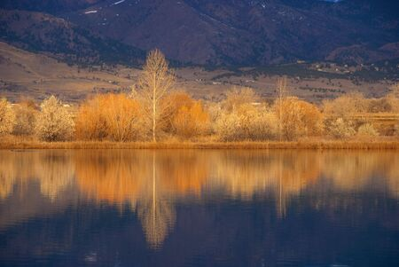 Small lake near Boulder, Colorado in the golden light of sunrise photo