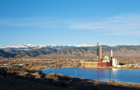 Electric plant by a lake in Colorado with view of snow-capped mountains Stock Photo - 6002516