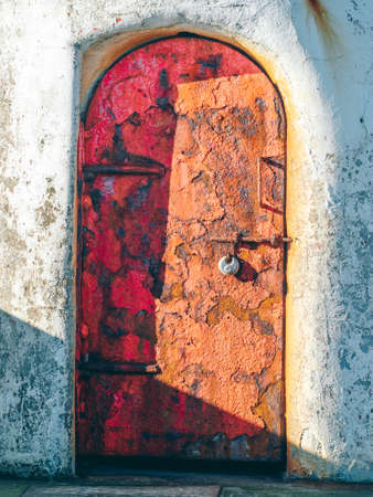 The rusted door of a long unused lighthouse in the Scottish seaside town of Girvan