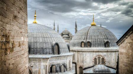 hagiasophia: Blue Mosque as seen through the domes of HagiaSophia in Sultanahmet Istanbul Turkey.