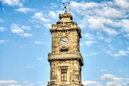 resides: Istanbul, Turkey - February 14, 2016: Dolmabahce Palace Clock Tower resides within the boundaries of Dolmabahce Palace, the final residence of Ottoman Sultans. Editorial
