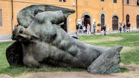 Pisa, Italy - September 04, 2014: Ikaro fallen created by the Polish contemporary artist Igor Mitoraj.