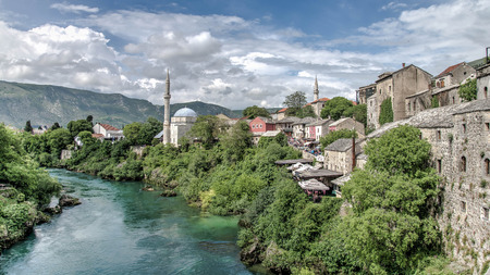 Mostar, Bosnia Herzegovina - May 1, 2014: Nerteva River and Old City of Mostar, with Ottoman Mosque Editorial