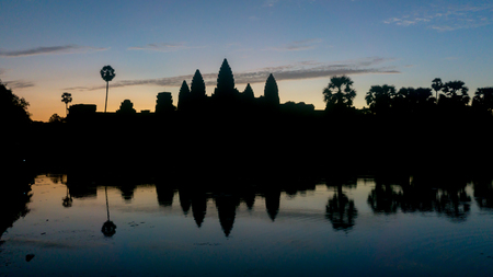 december sunrise: Siem Reap, Cambodia, December 06, 2015: Silhouette of Angkor Wat temple in Cambodia during sunrise. Angkor Wat is one of the famous tourist attraction in the world, located at Cambodia. Editorial