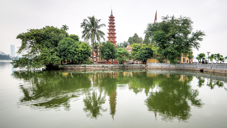 Hanoi, Vietnam - December 04, 2015: Tran Quoc pagoda in early morning in Hanoi, Vietnam. This pagoda is located on a small island near the southeastern shore of West Lake. This is the oldest Buddhist temple in Hanoi. Editorial