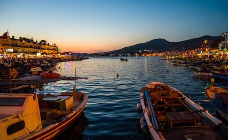 Foca, Turkey - September 29, 2013: Fishing boats at dawn in Foca town near Izmir, Turkey