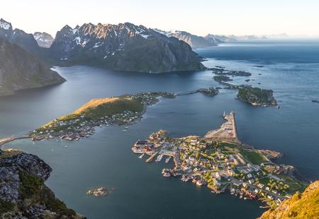 Reinebrinen, Norway - June 1, 2016: Beautiful norwegian landscape with famous top peak Reinbringen, Lofoten Islands and view on famous fishing village Reine, Moskenesoya and norwegian sea Stock Photo