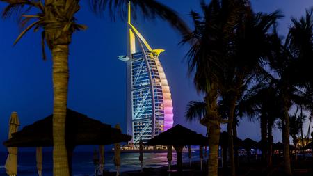 Dubai, UAE - May 31, 2013: Cityscape of Jumeirah beach with Burj El Arab Hotel. Dubai, United Arab Emirates