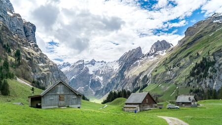 Seealpsee, Switzerland - May 2017: Seealpsee lake with the Swiss Alps in the background, Appenzeller Land, Switzerland