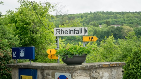 Laufen, Switzerland - May 2017 The sign bearing the German name of the Rhine Falls Rheinfall. Laufen castle is a castle overlooking the Rhine Falls.