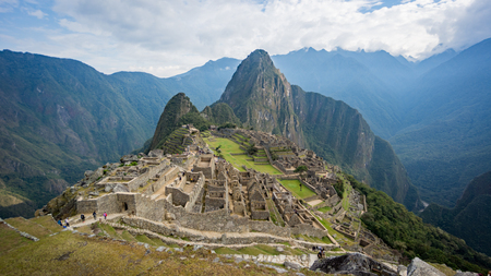 Machu Picchu, Peru - September 2017: View of the Lost Incan City of Machu Picchu near Cusco, Peru. Machu Picchu is a Peruvian Historical Sanctuary and a UNESCO World Heritage Site.