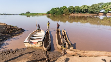 Omorato, Omo Valley, Ethiopia - September 2017: Traditional dassanech boats on the Omo river. Dugout boats are made from a hollowed tree trunk.