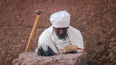 Lalibela, Ethiopia - September 2017: Pilgrim at one of the old rock churches from Lalibela Editorial