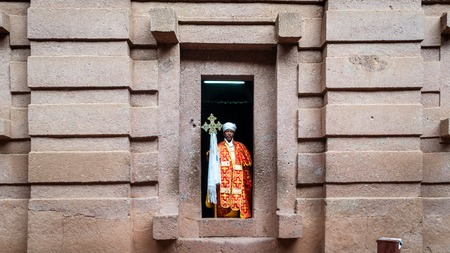 Lalibela, Ethiopia - September 2017: Unidentified priest at one of the old rock churches from Lalibela