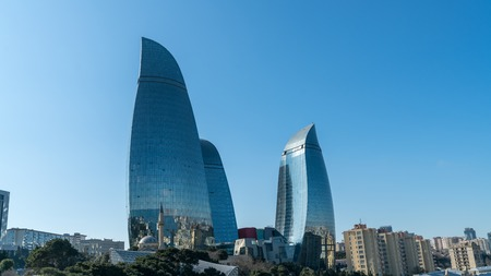 Baku, Azerbaijan - April 2018: View of Flame Towers from seafront near Milli Park. Flame Towers - the highest building in Azerbaijan located in Baku. Highest building Baku Flame tower