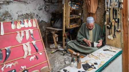 Fez, Morocco - April 2018: Craftsmen in the Medina o Fez city working traditional handycrafts, Morocco