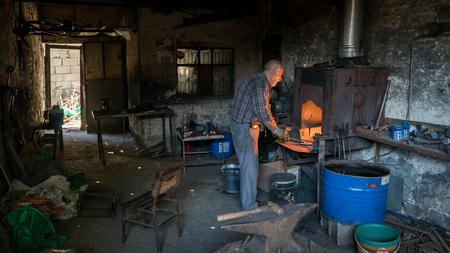 Adiyaman, Turkey - July 2018: Tailor working on traditional handycrafts in the Adiyaman city historical old Oturakci bazaar inside the old city, Turkey