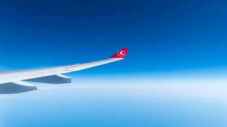 Istanbul, Turkey - July 2018: Turkish Airlines airplane wing at the sky Редакционное