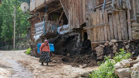 Artvin, Turkey - July 2018: Unidentified woman in local outfit walking in Maden Village , Savsat, Artvin, Turkey