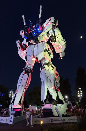 Tokyo, Japan - August 2018: Unicorn Gundam statue life size standing front of Diver city plaza Tokyo in Odaiba