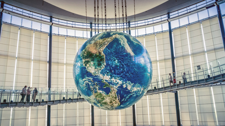 Tokyo, Japan - August 2018: A giant globe with interactive projections inside National Museum of Emerging Science and Innovation, Miraikan, Tokyo, Japan