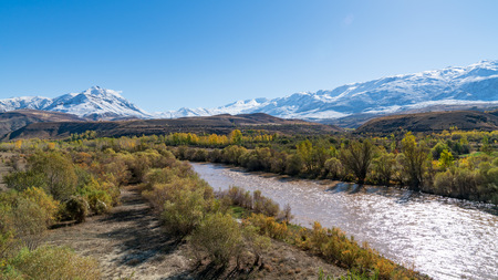 View of a valley with snow capped mountains and River Euphrates near Erzincan, Turkey