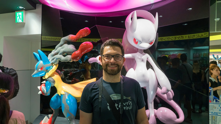 Tokyo, Japan - August 2018: Happy tourist posing infront of a Pokemon figure at Pokemon Center store in Sunshine City shopping mall in Tokyo, Japan Editöryel