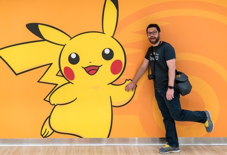 Tokyo, Japan - August 2018: Happy tourist with a Pokemon Pikachu figure at Pokemon Center store in Sunshine City shopping mall Editöryel